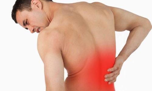 При дизурическом расстройстве часто возникает дискомфорт не только в области уретры, но и в спине (пояснице)